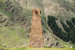 Ancient Stone Watchtower On Mountain Background In Sioni Village Stock Photos
