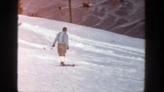 1961: people skiing in the slopes of a hill and enjoying the sport ASPEN Stock Footage