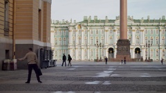 Group of tourists with a guide on a background of Palace Square Stock Footage