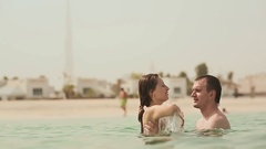 The guy and the girl happy and swimming in the sea Stock Footage