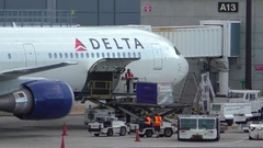 Delta Airlines loads cargo shipping containers, departure flight Stock Footage