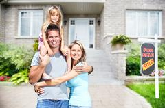 Happy family near new house. Stock Photos