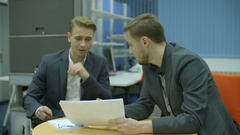 The businessman discuss agreement in the office. Real time capture Stock Footage