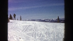 1961: skier walking to the crest of a well-used bunny ski slope ASPEN COLORADO Stock Footage
