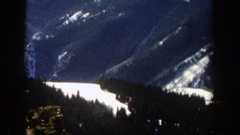 1961: a lot of pines in a snowy valley and surrounded by great mountains ASPEN Stock Footage