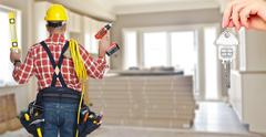 Electrician with drill and cable. Stock Photos