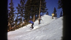 1961: three people skiing down a slope with snow ASPEN COLORADO Arkistovideo