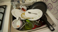 Dirty dishes in the sink Stock Footage