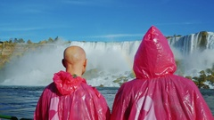 NIAGARA FALLS, NY, USA: view from the back of two tourists in Niagara Falls Stock Footage
