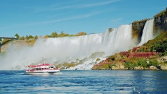 NIAGARA FALLS, NY, USA: : Boat with tourists floats near Niagara Falls Stock Footage