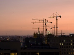 Construction cranes working at sunset in Downtown Los Angeles ELS 4K Stock Footage