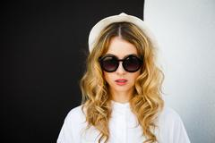 Portrait of Fashion Hipster Girl at Contrast Wall Stock Photos