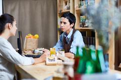 Talk with consumer Stock Photos
