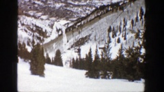 1961: skiers on a ski lift in snowy forest environment ASPEN COLORADO Stock Footage