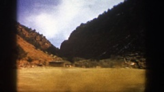 1961: hills covered with evergreen trees, billboards, and widely spaced homes Stock Footage
