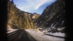 1961: riding by snowy mountains on sunny day ASPEN COLORADO Stock Footage