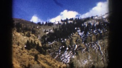 1961: lush mountains covered with trees and settled snow. ASPEN COLORADO Stock Footage
