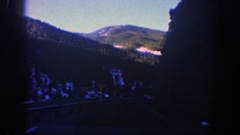 1961: driving by a yield sign in the mountains. ASPEN COLORADO Stock Footage