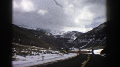 1961: old footage of a person or family driving into a mountainous region during Stock Footage