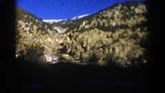 1961: a clear dark blue sky sits above a snowy mountain peak ASPEN COLORADO Stock Footage