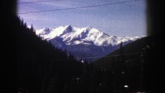 1961: breath-taking, snowcapped mountain view with mature trees ASPEN COLORADO Stock Footage