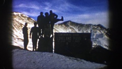 1961: silhouettes of people posing on top of a big mountain in winter ASPEN Stock Footage