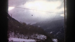 1961: power lines running across a snowy mountain view ASPEN COLORADO Stock Footage