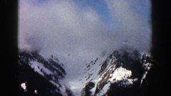 1961: clouds rapidly moving through a snow-covered valley ASPEN COLORADO Stock Footage