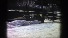 1961: a long sport utility vehicle moving through a road covered under snow Stock Footage