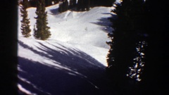 1961: traveling over a snowy mountain side with pine trees ASPEN COLORADO Stock Footage