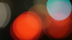 Big color bokeh circles from urban traffic at night Stock Footage
