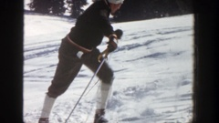 1961: a skateboarder climbs up and then proceeds to ski at a fast rate down a Stock Footage