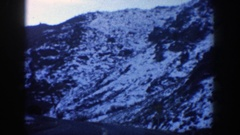 1961: driving on blacktop towards a tunnel with snow on the sides and adjacent Stock Footage