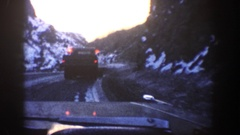 1961: a car rides behind a snow plow on an icy road ASPEN COLORADO Stock Footage