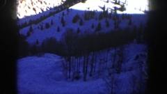 1961: steep snow clad mountain with greenery surrounded all over ASPEN COLORADO Stock Footage