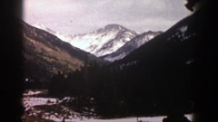 1961: a tranquil view of snowy mountains in the wilderness ASPEN COLORADO Stock Footage
