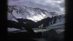 1961: the car moving around the full mist and snow mountain ASPEN COLORADO Stock Footage