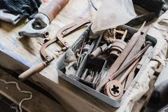 Still life tool box with nails rasp and old tools Stock Photos