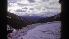 1961: snow and trees with ski runs down the side of the mountain ASPEN COLORADO Stock Footage