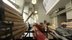 Drummer taking drum sticks from a shop - detail shot Stock Footage