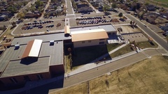 2016: aerial shot of a building with a parking space COLORADO Stock Footage