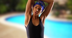 Closeup of African swimmer stretching upper body by pool. Stock Footage