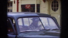 1958: man in black hat and companions getting out of black vintage car. KANSAS Stock Footage