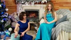 Christmas presents, joyful beautiful female give a gift, friends exchange Stock Footage