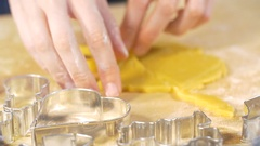 A woman is baking cookies in the kitchen. She makes the shortbread Stock Footage