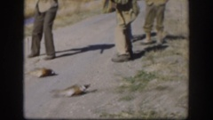 1958: group of men hunter shooting down ducks. KANSAS Stock Footage