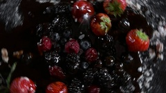 Fruits revolve and sprinkled with powdered sugar Stock Footage