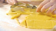 A woman is baking cookies in the kitchen. She cuts the shapes Stock Footage