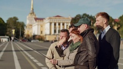 Group of tourists make selfie on a background of historic center Stock Footage