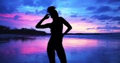 Single silhouette of sensual woman standing on sunset beach of the bahamas. Stock Footage